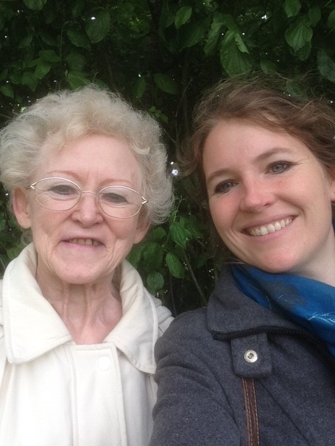 Photo of a young woman smiling with an older woman